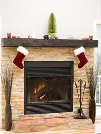 Drilling holes into your fireplace enables you to hang items from the brick.