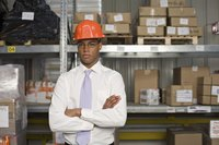 A portrait of a businessman in a warehouse.
