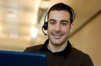 A call center employee talking on a headset.
