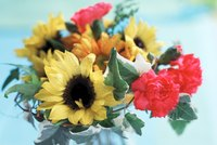 Add color and texture by using different flowers with sunflowers.
