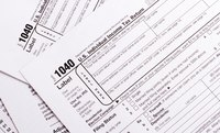 You could owe tax penalties on top of income taxes if you take a nonqualified 401(k) withdrawal.