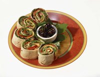 Tortilla roll-ups are pretty on a plate.