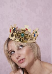 Be queen for a day with a vintage-looking metal crown.