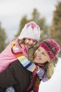 Create different patterns in knit hats by using different color yarns.