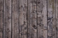 Weathered wood loses its natural color, giving a gray appearance.