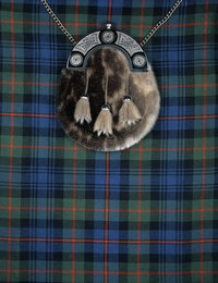 A kilt is topped with a sporrans in traditional Scottish wear.