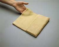 Repeated rolling and folding gives puff pastry or croissant dough its flakiness.