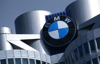 Close-up of the BMW emblem at the top of the BMW corporate headquarters building