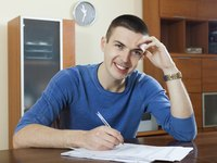 Man filling out form in kitchen