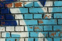 Remove spray paint off brick walls with solvents.