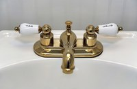 Shiny polished brass gives a bathroom an elegant touch.