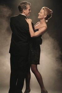 Keeping hair up and off the face is important for ballroom dancing.