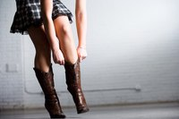 Show off your cowgirl boots with a short prom dress.