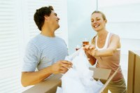 Young couple celebrating a new home with a glass of champagne.