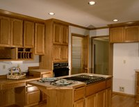 Consider changing flooring or paint colors to complement darker cabinets.