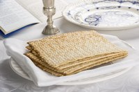 Unleavened bread, called Matzah, on a plate.