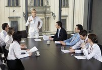 Woman leading business meeting in office