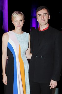 Head Dior designer Raf Simons appears with Princess Charlene of Monaco at a cocktail party marking the Dior Cruise Collection 2014.
