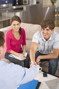 A young couple is having a meeting with a financial adviser.