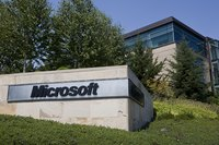 A Microsoft sign in front of a building on the company's campus in Redmond, WA