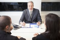 Business accountant talking to employees