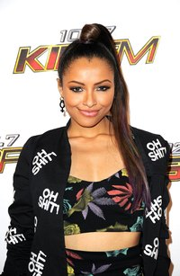 Use two ponytails to add length and body to your updo like actress Kat Graham.
