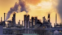 Wide shot of an oil refinery at sunset