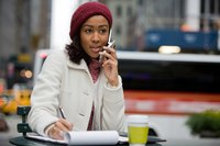 A young businesswoman is having a discussion on her phone.