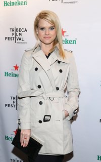 Alice Eve wears her trench unbuttoned and belted at the Tribeca Film Festival 2013 after party in New York.