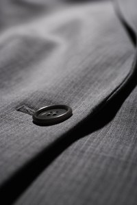 Pinch the layers around the bottom buttonhole of a suit jacket to determine if the lining is fused or canvassed.