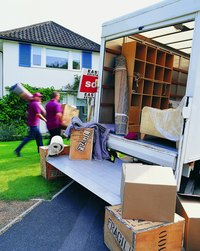 The employee may use a professional moving company or handle the task himself.