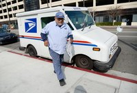A postal worker outside his USPS truck