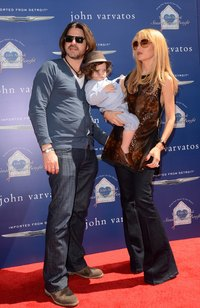 Rodger Berman, in a blue cardigan, is red carpet-ready with wife and son.