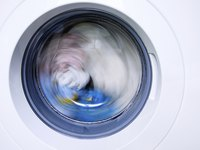 Adding bleach to your washing cycle can help to remove color from white nylon fabrics.