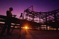 Silhouette of construction workers at a site at night
