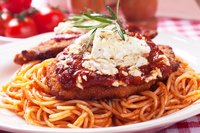Spaghetti is a popular pasta choice for chicken Parmesan.