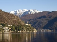 Lugano surrounds Lake Lugano, with panoramic views of the Swiss Alps.
