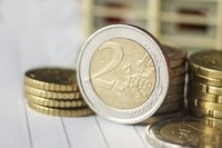 Close up of euro coins on counter