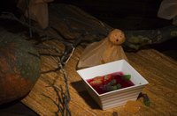 Garnish the black Jell-O with gummy worms for a classic spooky treat.