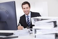 Business accountant working at desk
