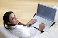 Young woman using laptop computer from home.