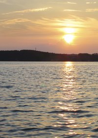 Guests can enjoy catered meals in the glow of the sun setting on Lake Norman.