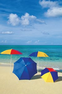 Use an umbrella at the beach to help prevent sun spots.