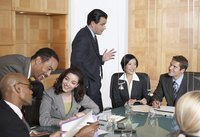 A group of business executives meeting in a conference room