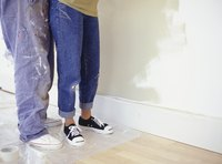 Clean grape juice stains from beautifully painted drywall patiently and carefully.