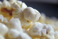 Season popcorn as soon as it pops so the starch absorbs more flavor.