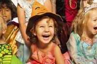 Close up of children dressed in Halloween costumes.