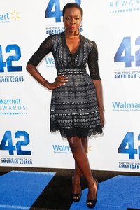 "Danai Gurira wears black peep-toe pumps with her black dress at the ""42"" movie premiere in Hollywood, California in 2013."