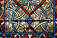 A stained glass design is one option for covering mirrored doors.
