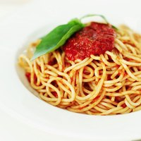 Pasta Bolognese gives you a taste of Italy with tomatoes, ground meat and fresh basil.